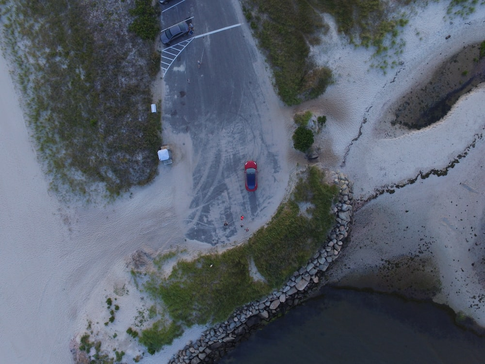 aerial photo of red vehicle on road