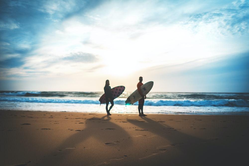 two person on seashore