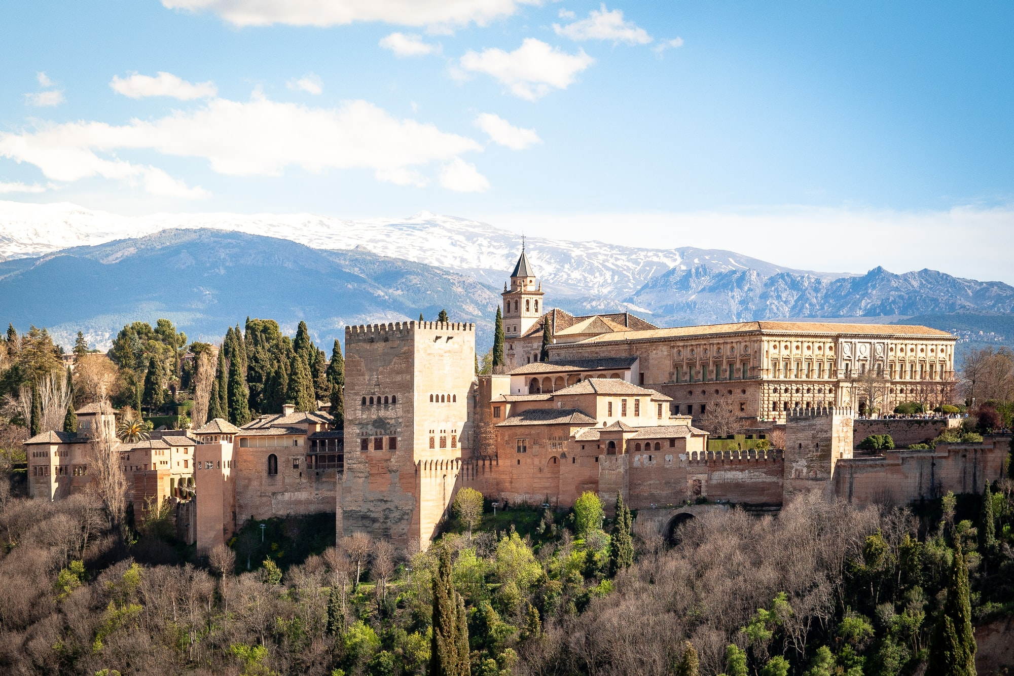 Alhambra palace in spring, Granada, Spain. In early April the mountains are still covered in snow.