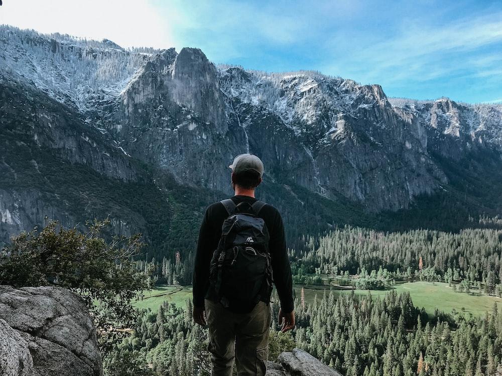 man standing on rock mountain