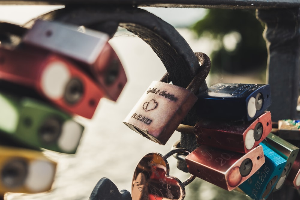 assorted-color padlock lot close-up photography