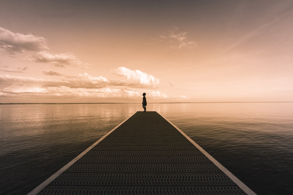 boy standing on dock