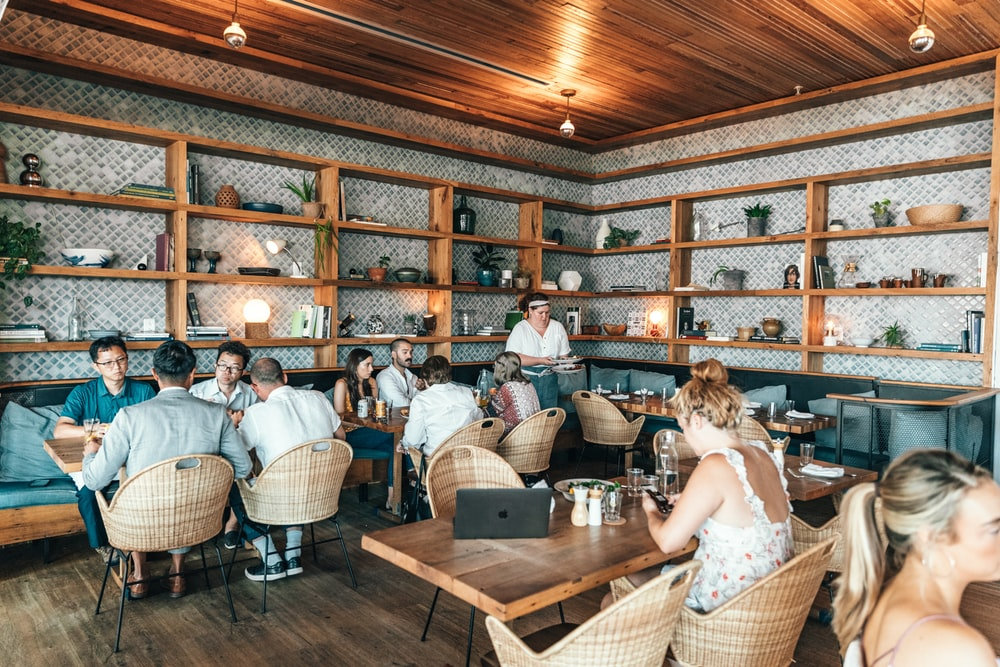 people sitting inside restaurant close-up photography