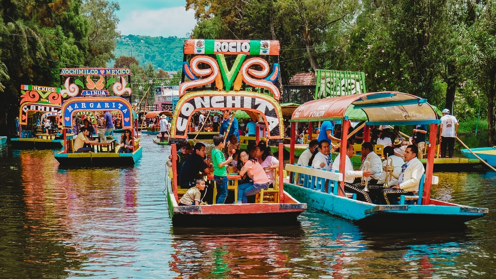 people riding tour boats during daytime