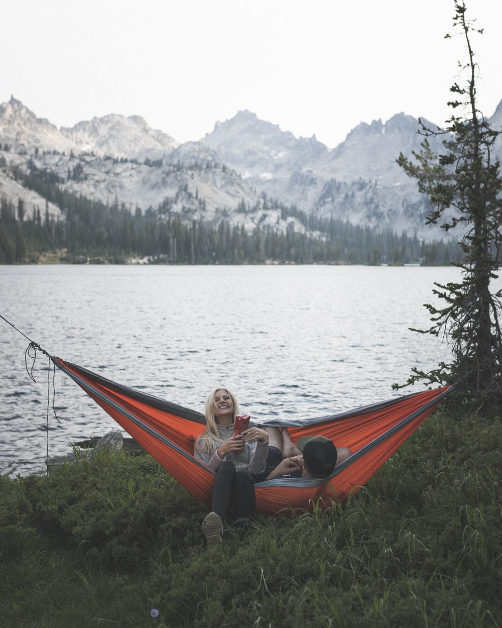 two person riding on hammock swing