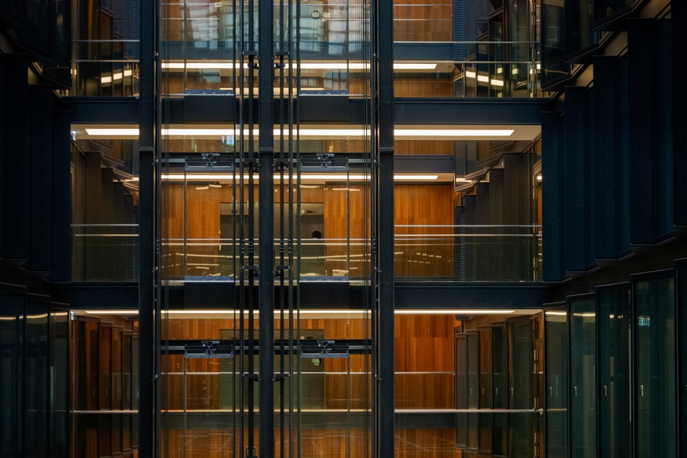 turned on lights inside clear glass building