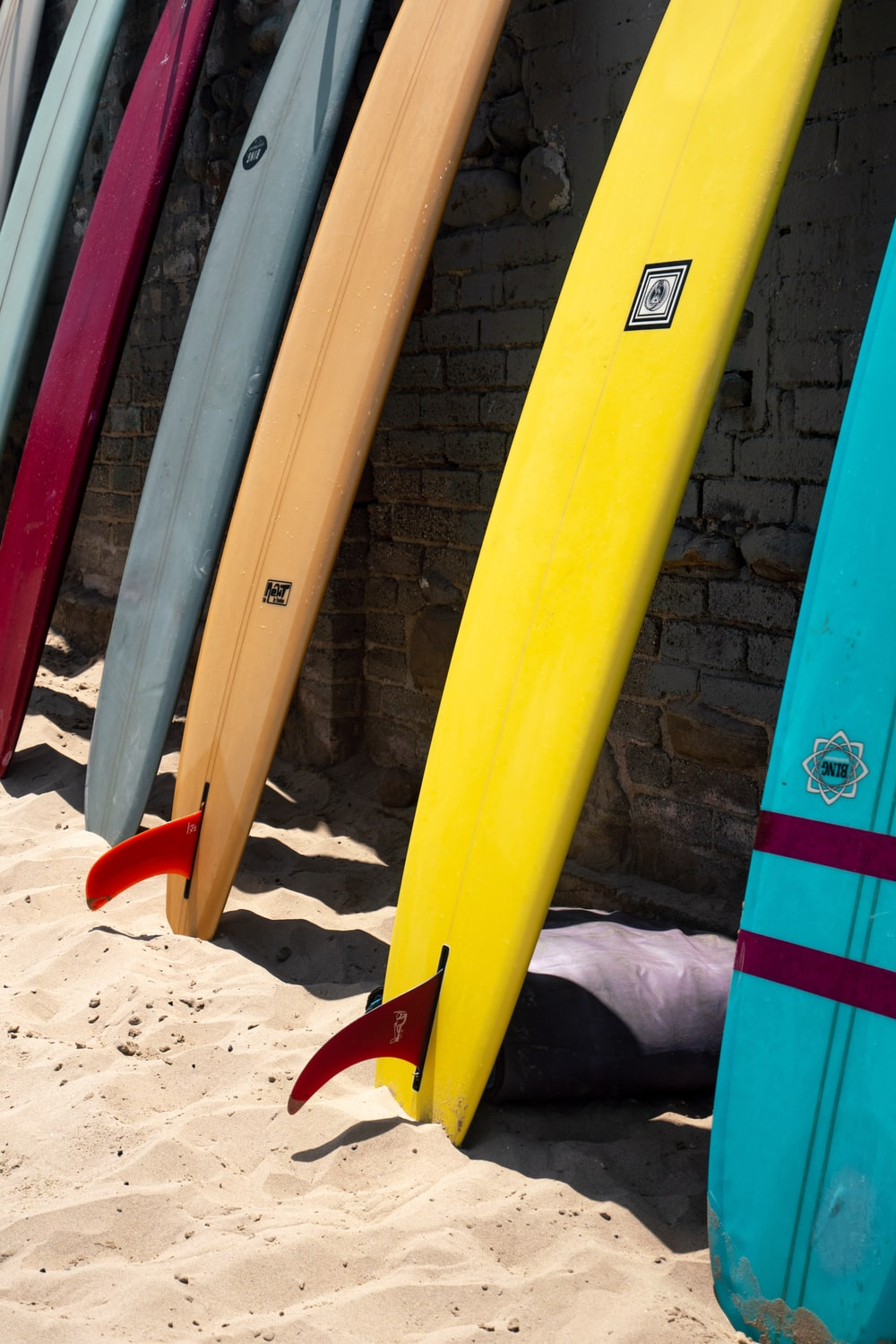 assorted-color surfing boards
