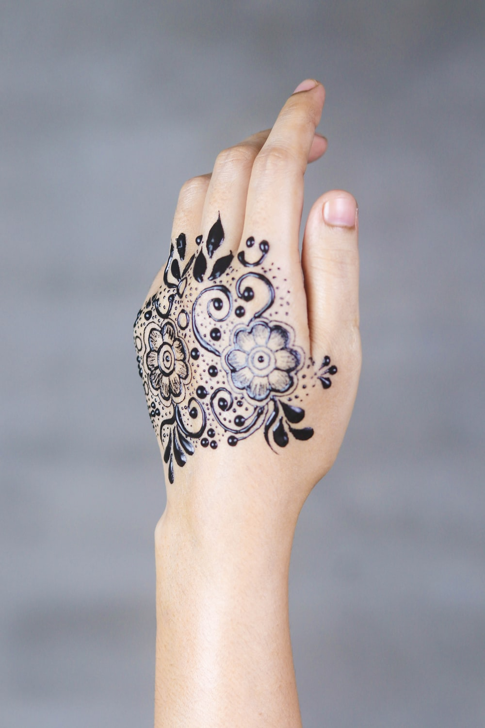 person's blue petaled flower tattoo