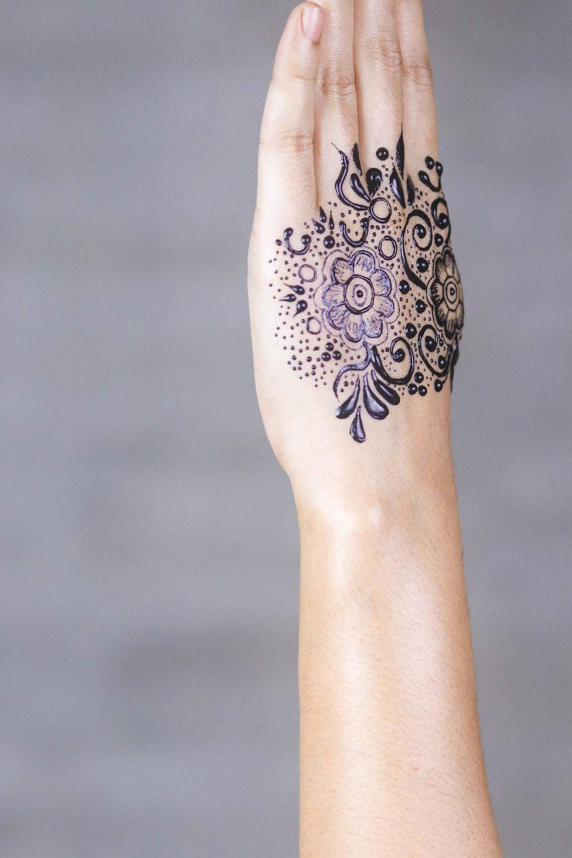 person's purple petaled flower tattoo