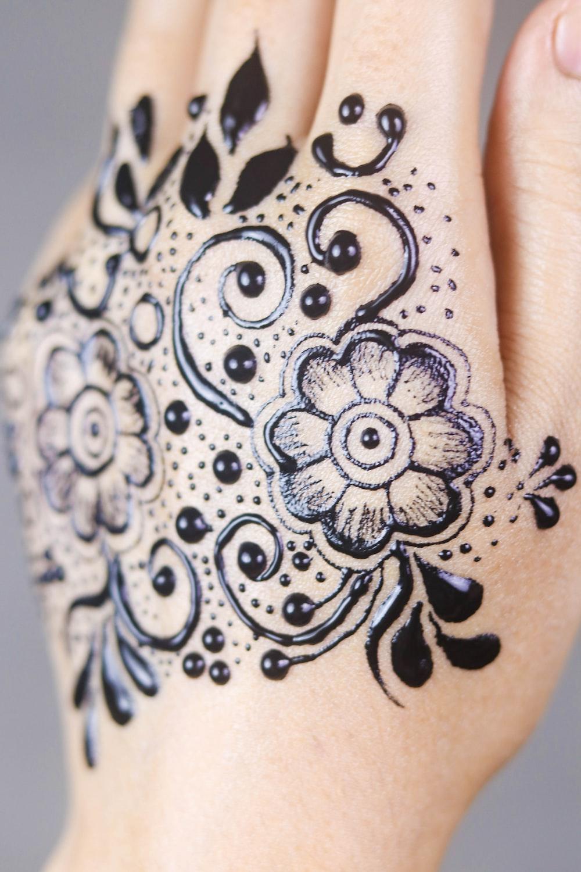 black floral hand tattoo art