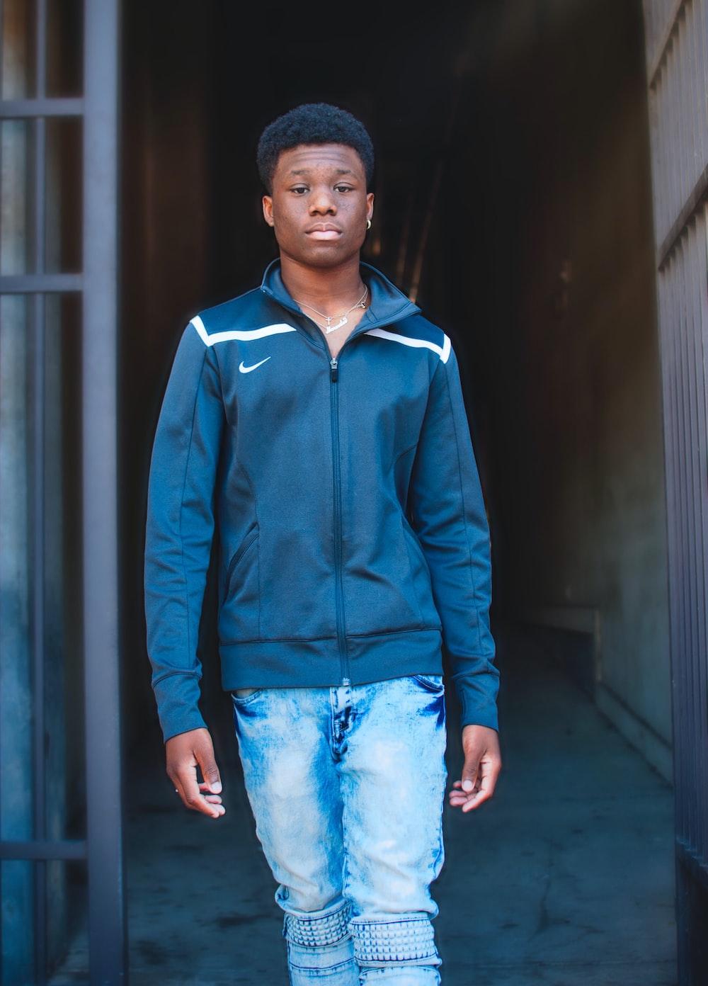 man about to walk wearing black Nike jacket