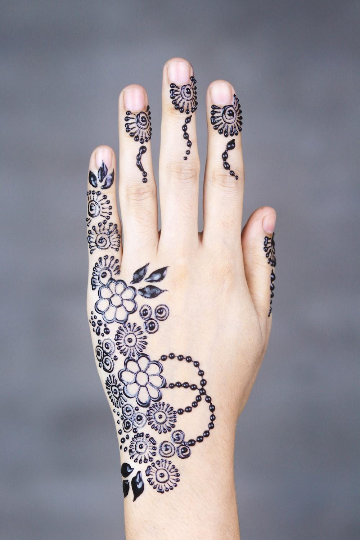 black-ink floral arm tattoo