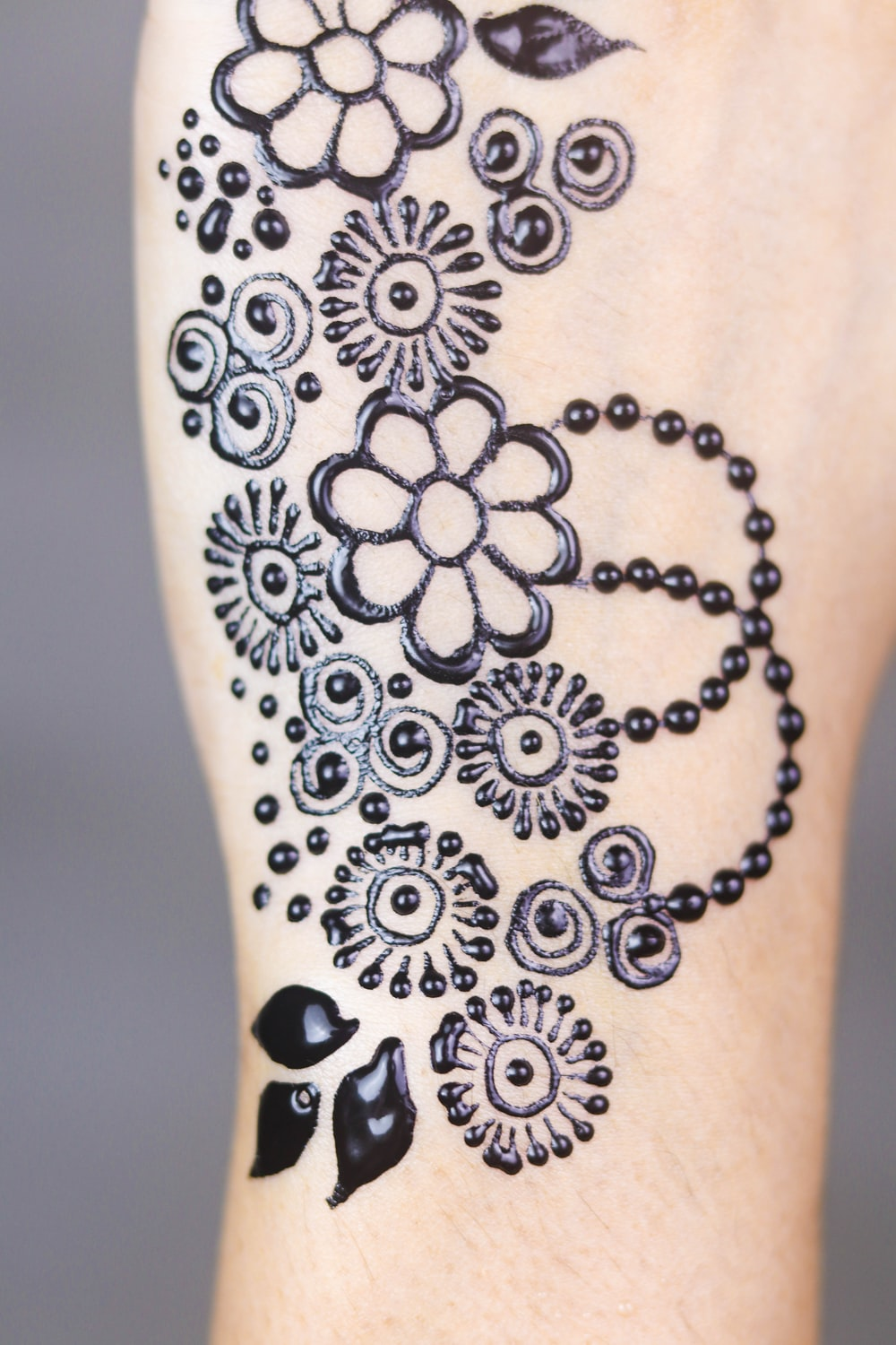person's petaled flower tattoo