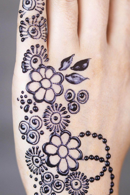 black floral mendhi tattoo