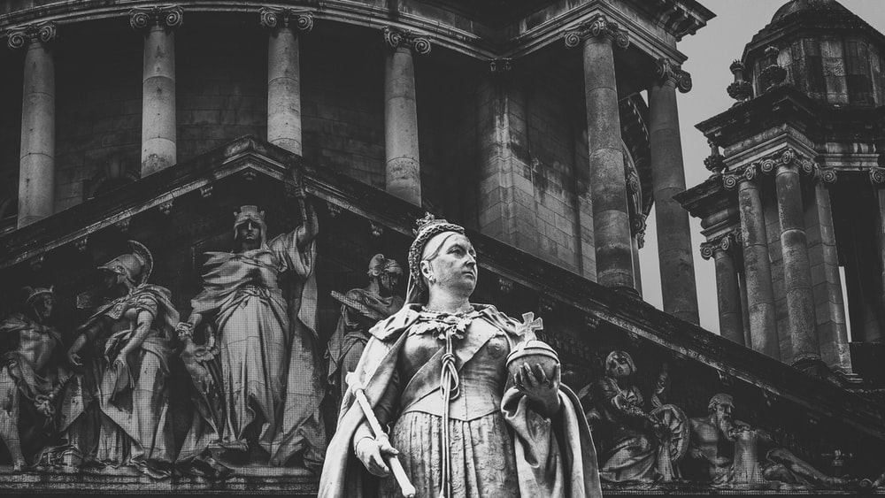 grayscale photography of statue