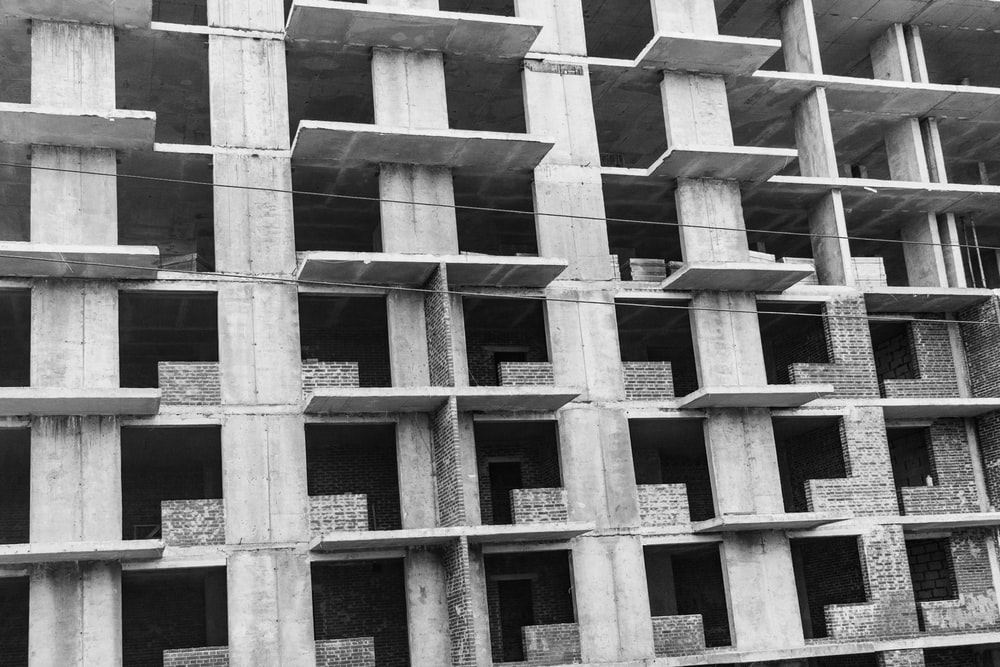 grayscale photo of multi-storey building