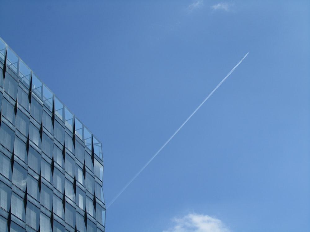 high-rise curtain wall building under blue sky