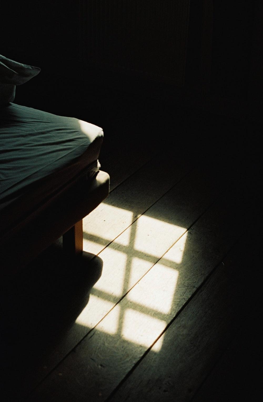 reflection of window on brown wooden floor