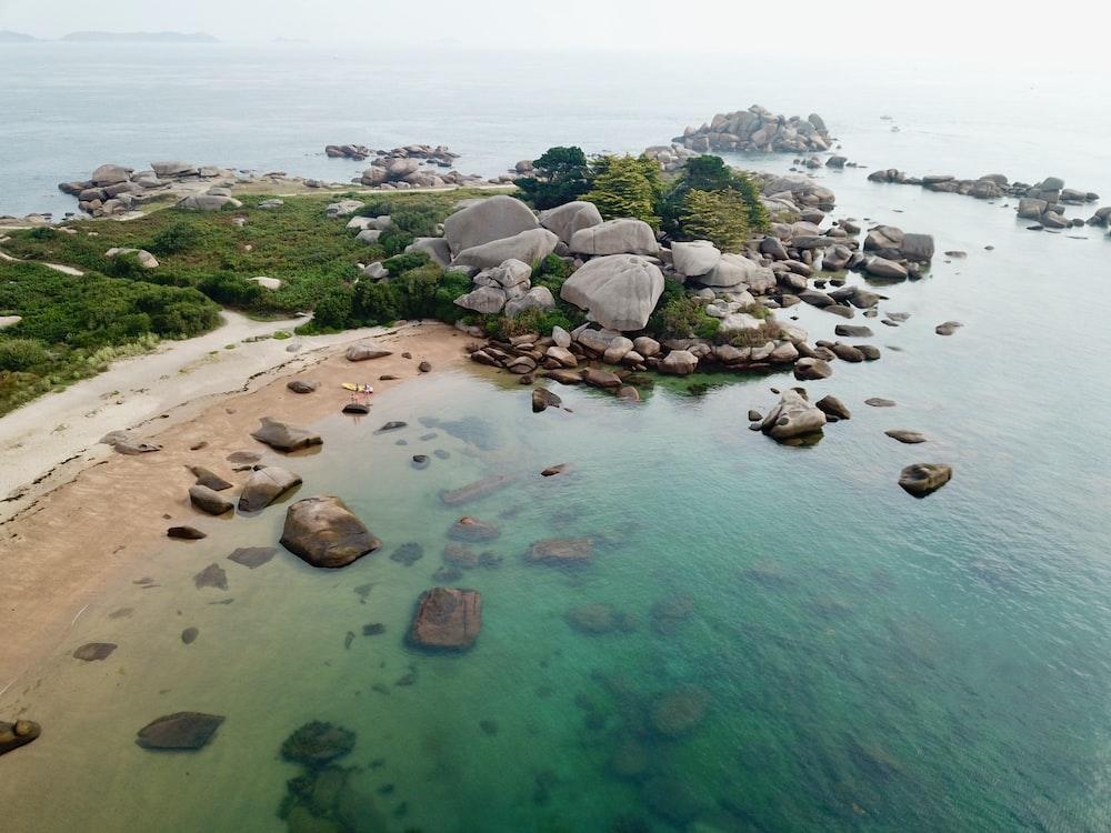 calm water near rocks