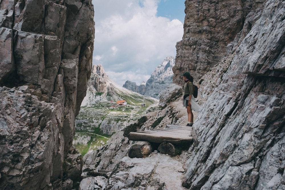 woman standing beside rocks