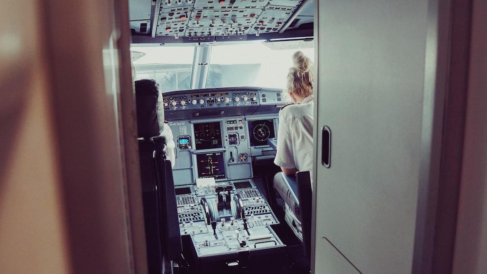 woman sitting on pilot deck