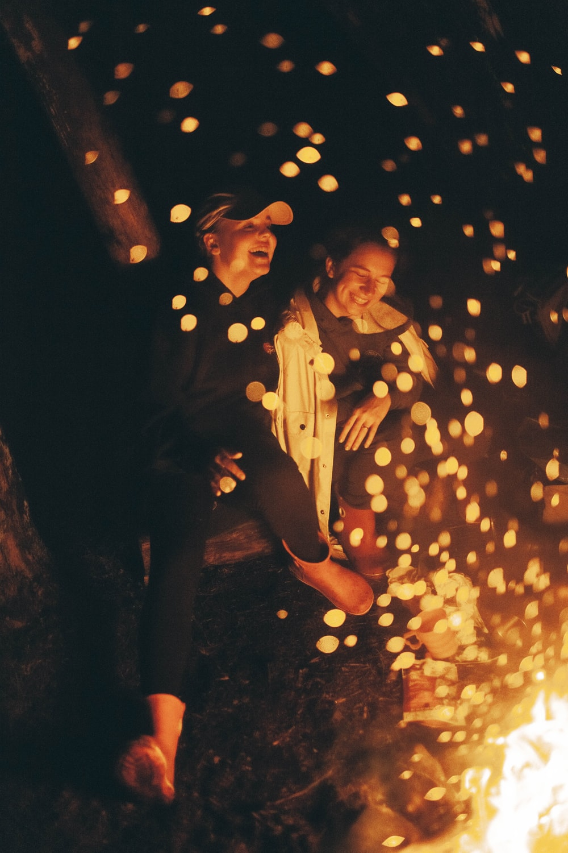 smiling women doing bonfire
