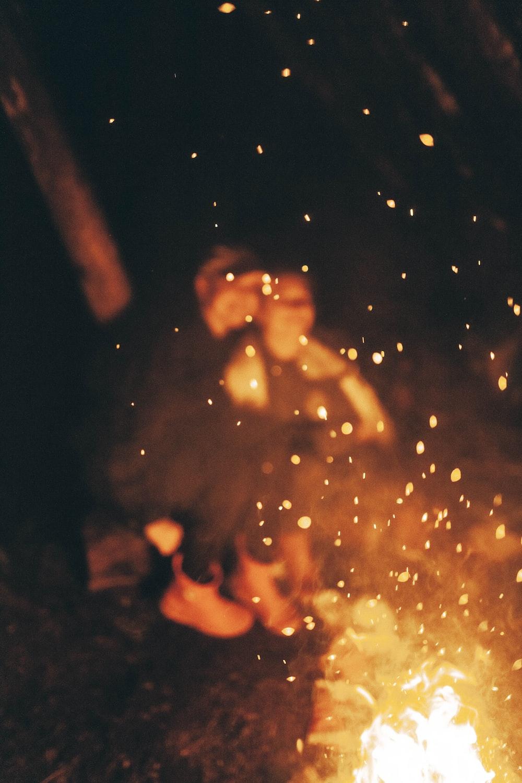 two person sitting near bonfire