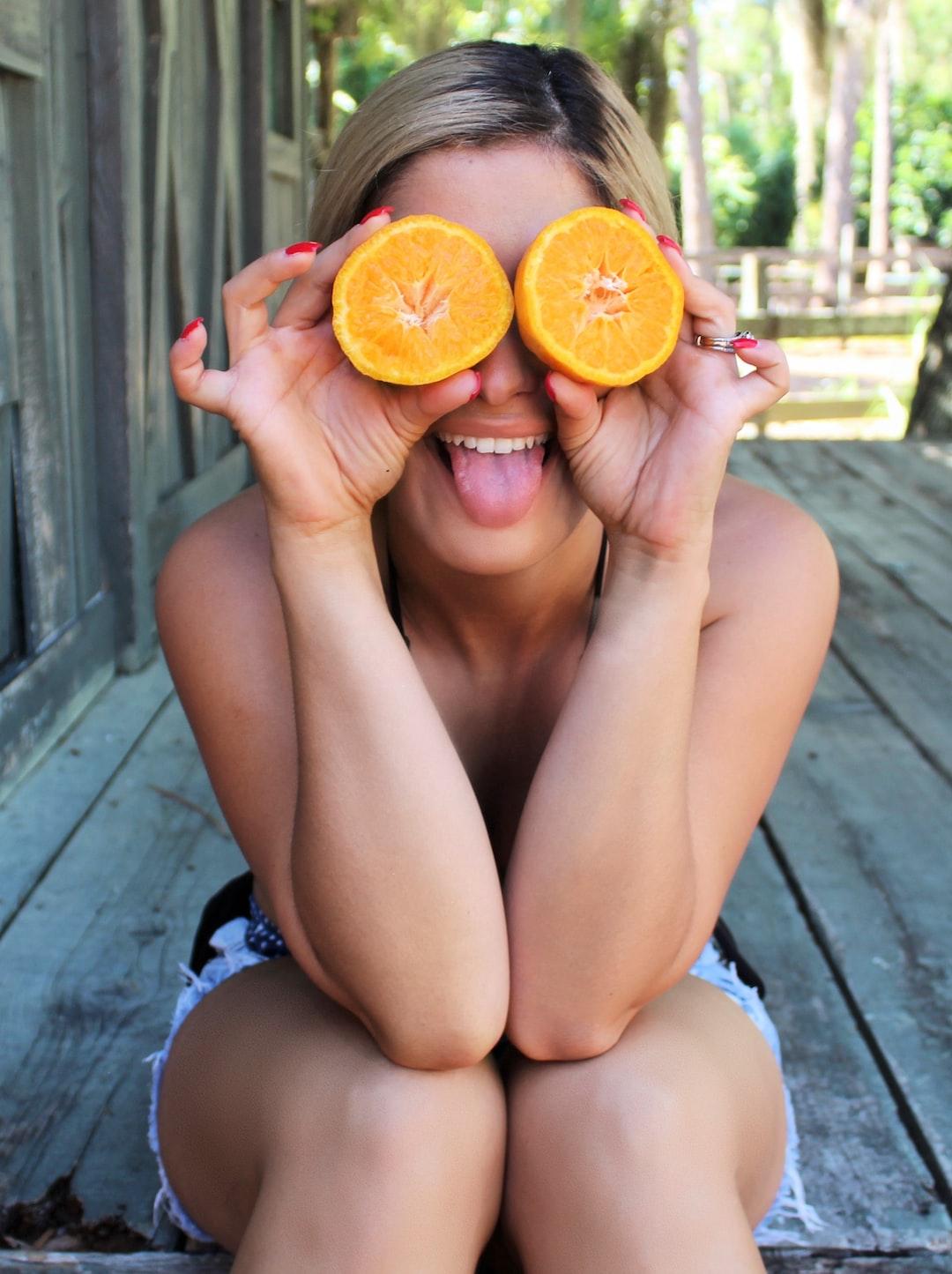 model posing with oranges