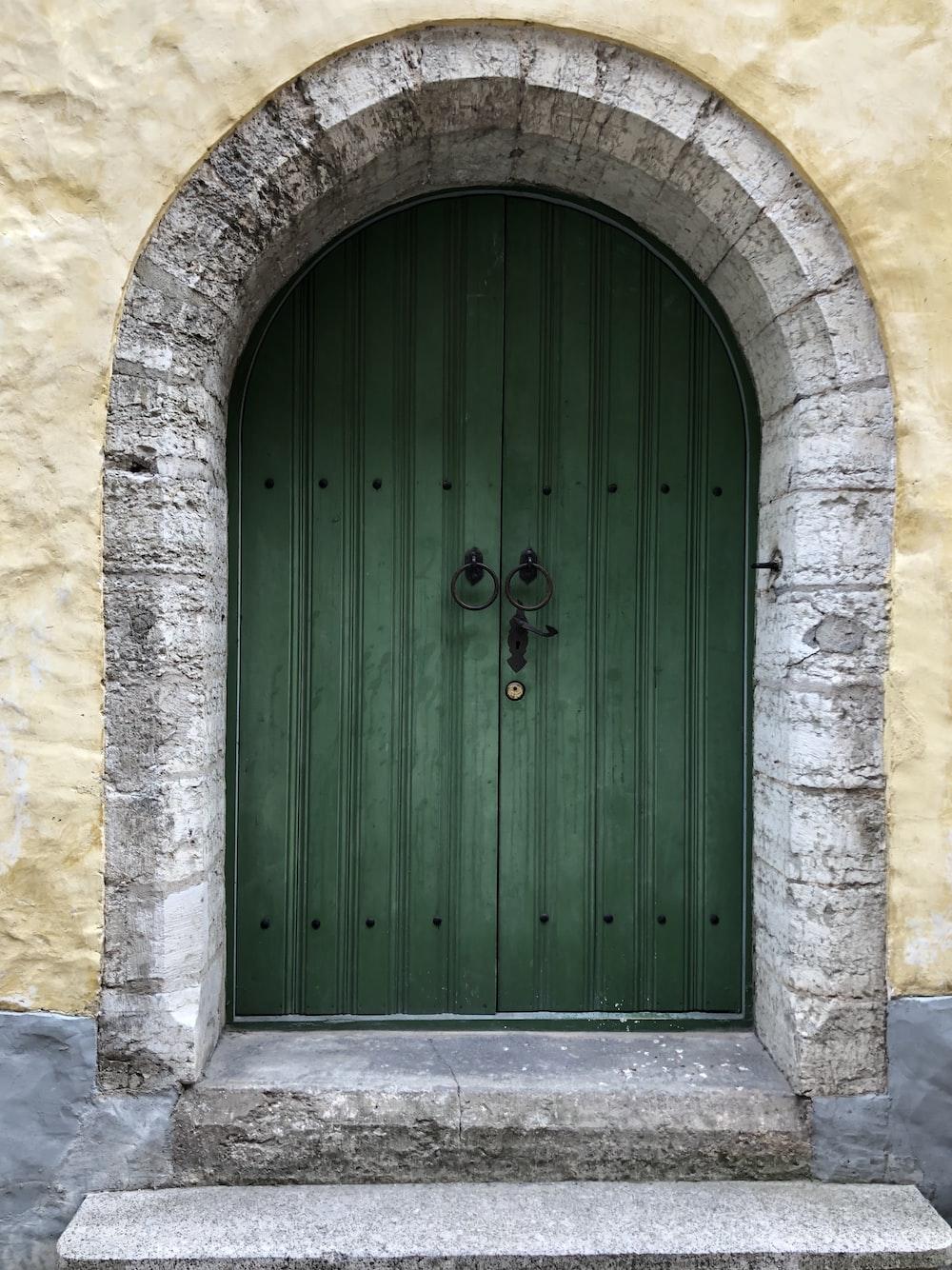 green door with black knocker