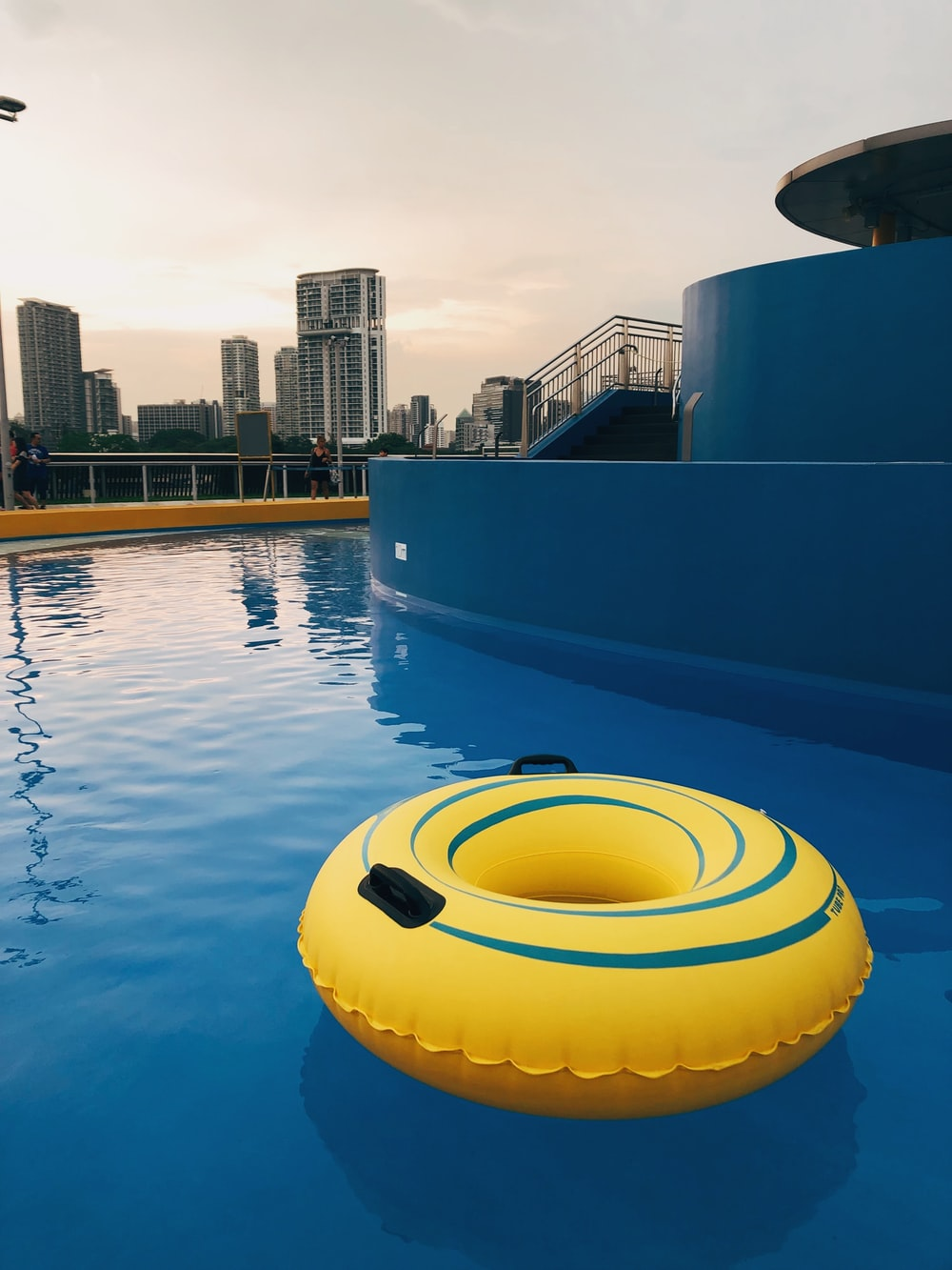 yellow and blue inflatable floater