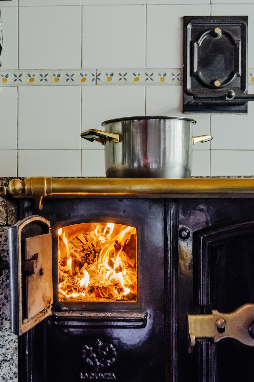 casserole on black firewood stove
