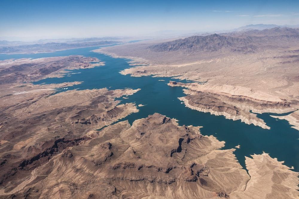 aerial photography of lake between desert