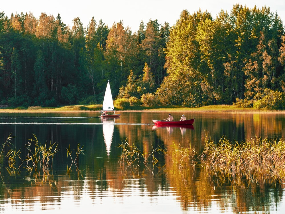 two person on red sailboat