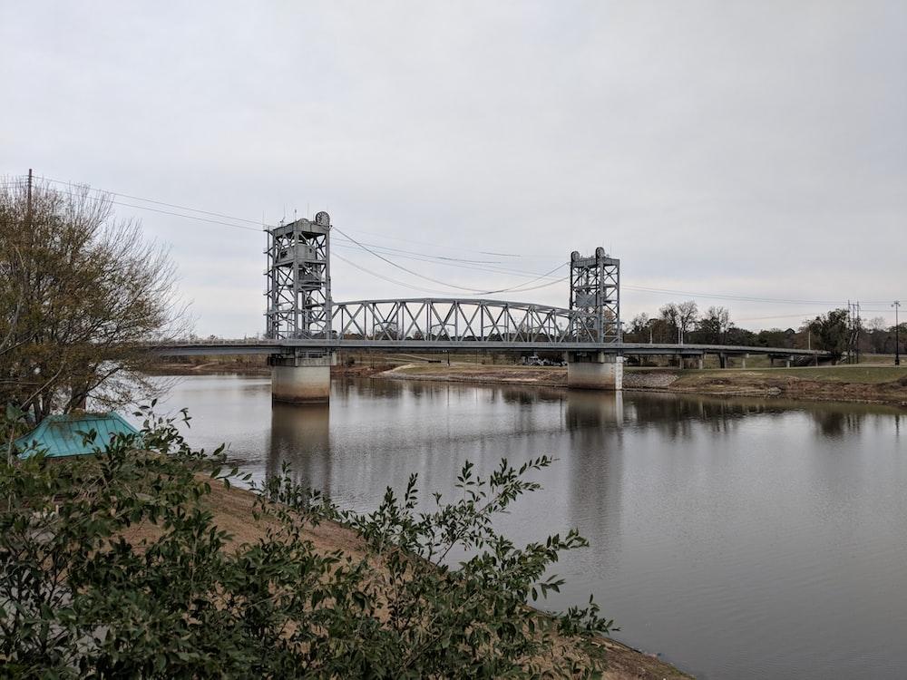 gray metal bridge over water