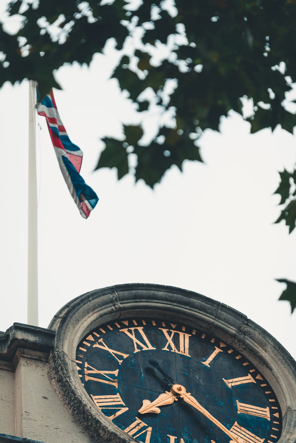 waving flag over clock