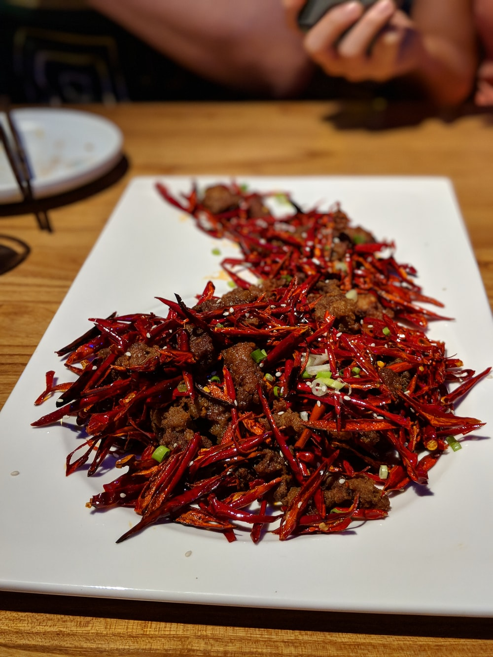 dried chilies on rectangular white ceramic plate