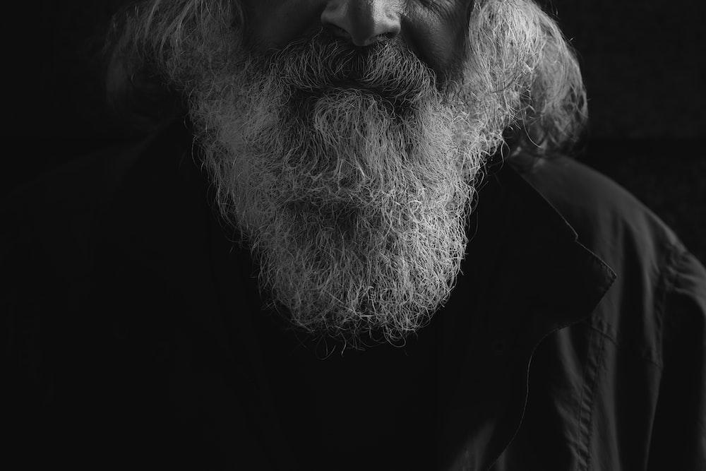 man's beard grayscale photo