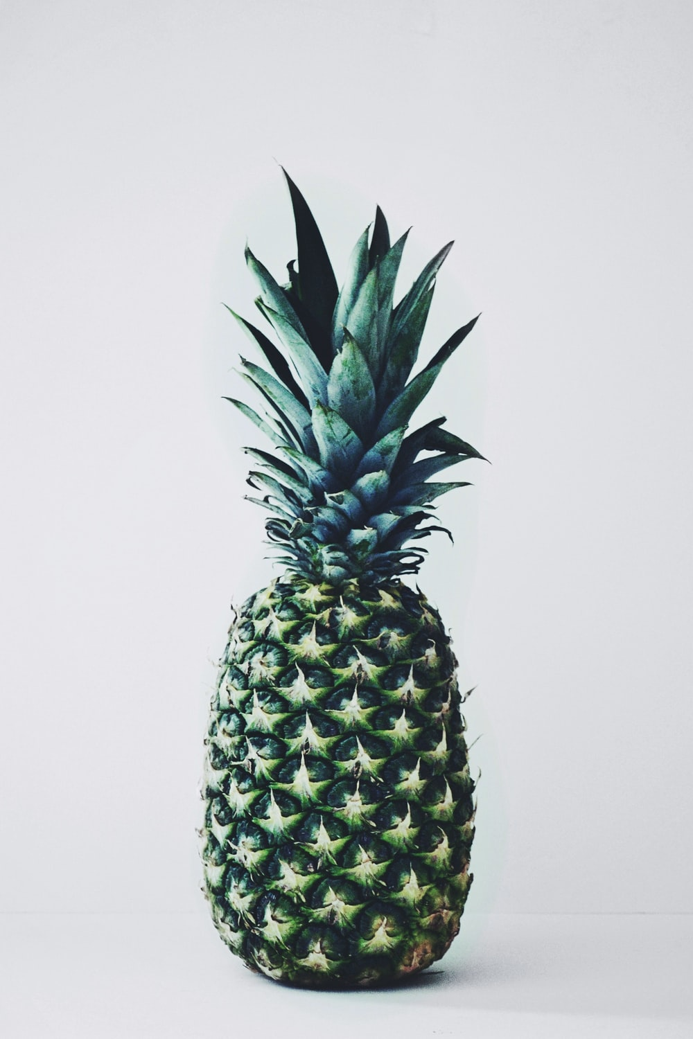 green pineapple on white background