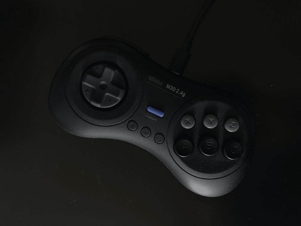 gray and black SEGA Genesis controller