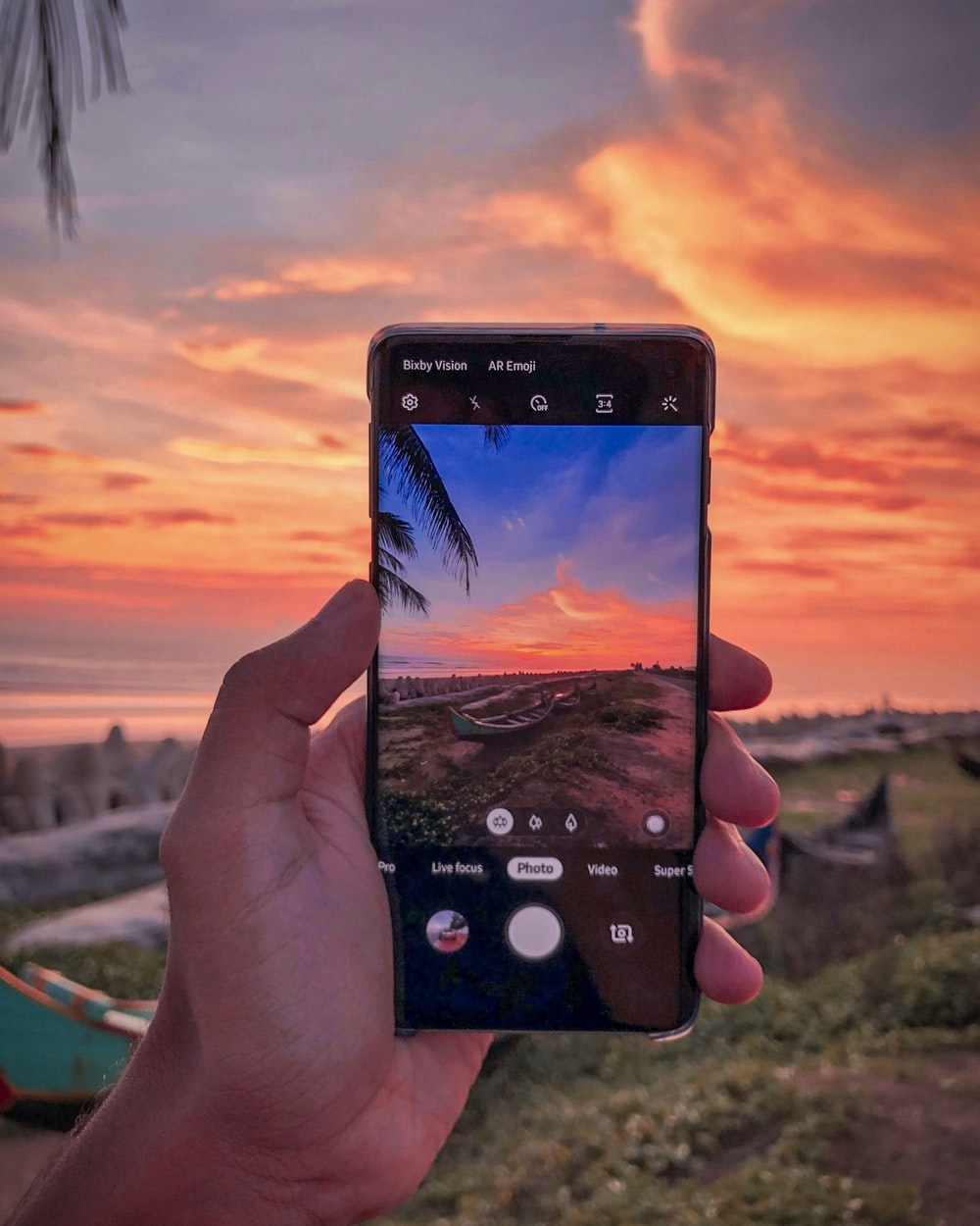 person capturing sunset