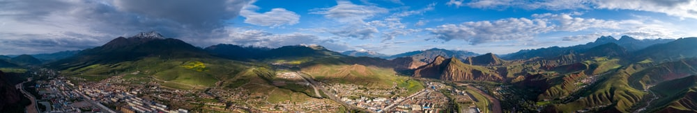 panoramic photography of ruins at the mountain during daytime