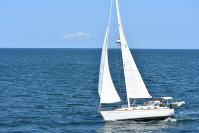 white yacht in body of water during daytime