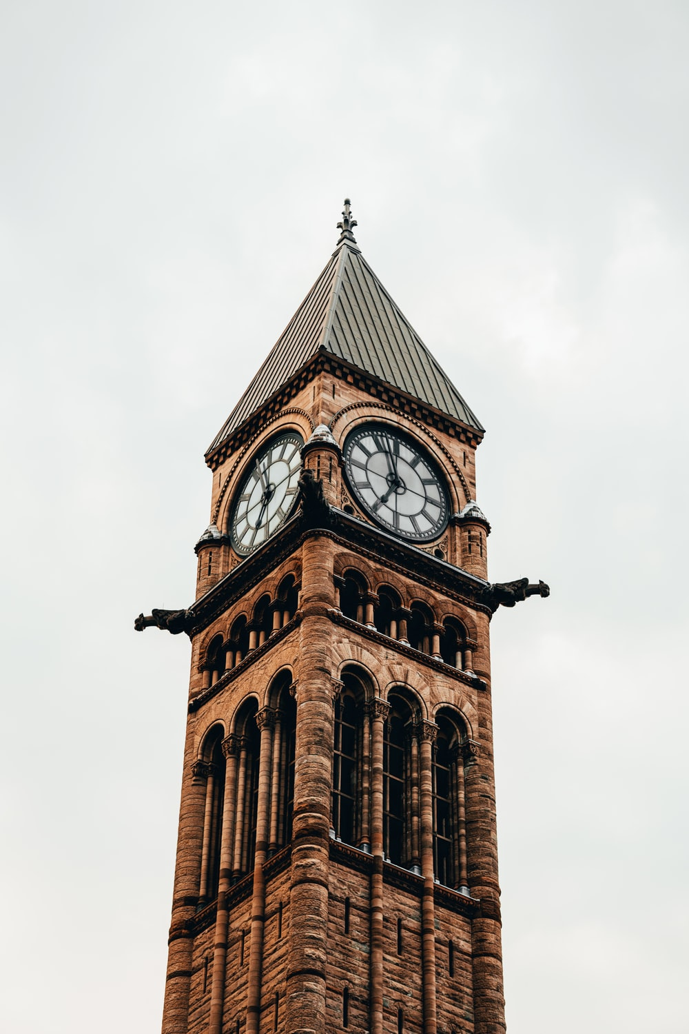 low angle photo of tower with clock
