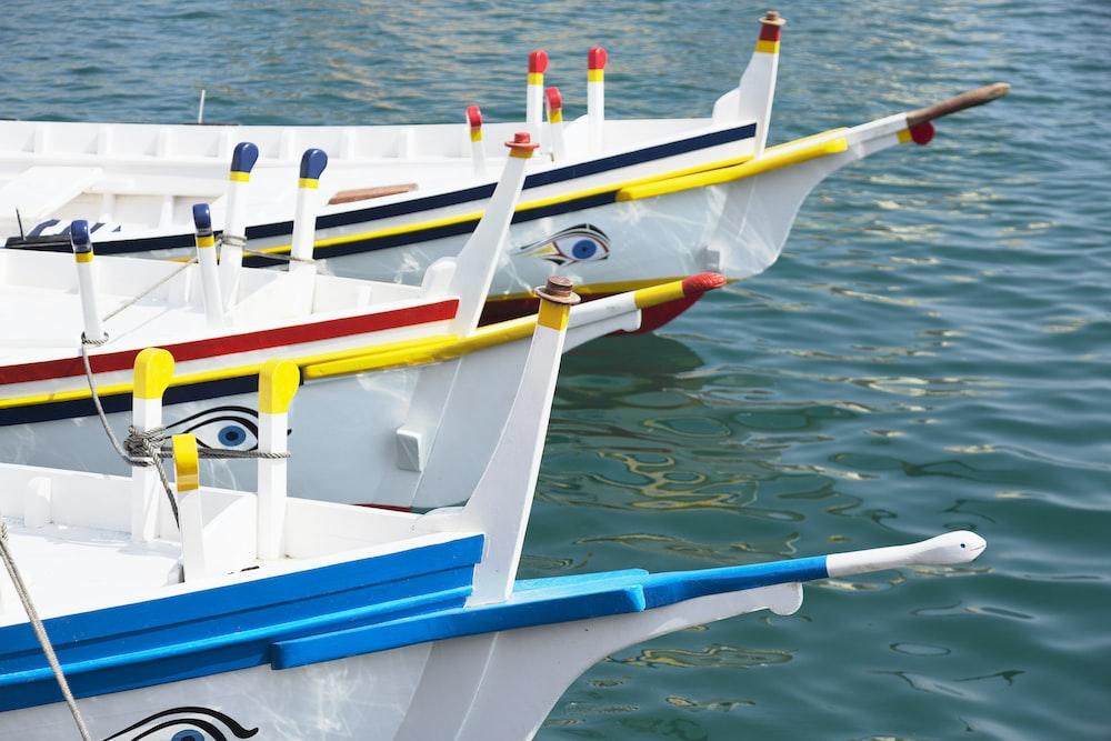 closeup photo of three white boats