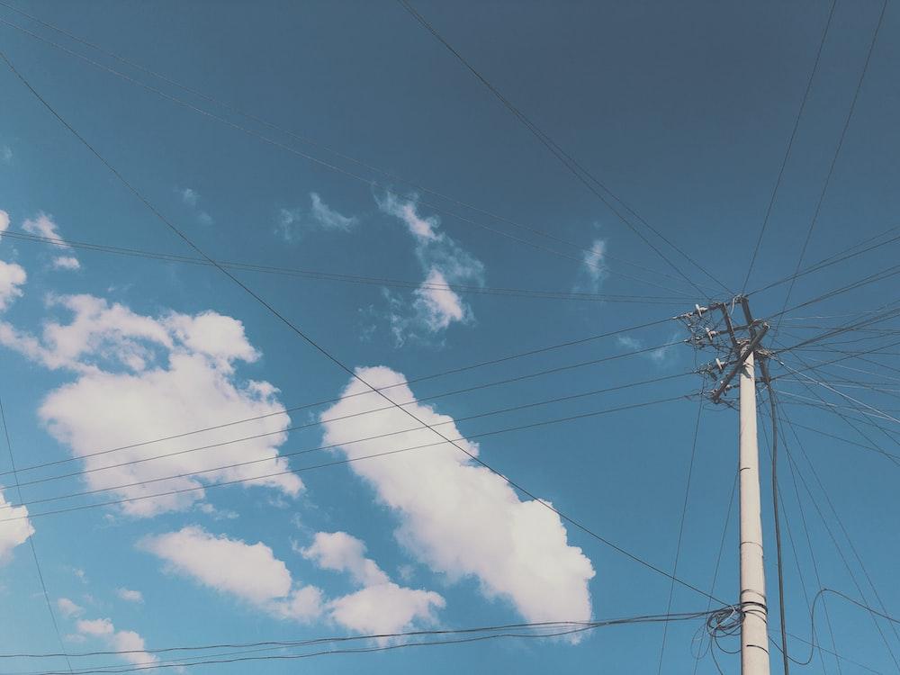 utility post under blue sky