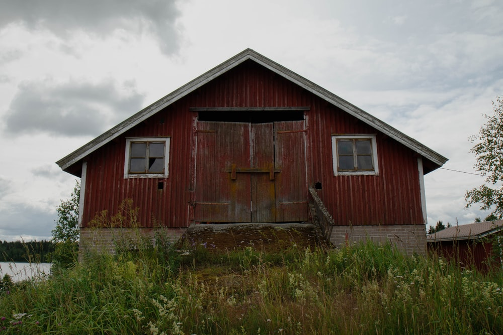 red and gray wooden house at daytime