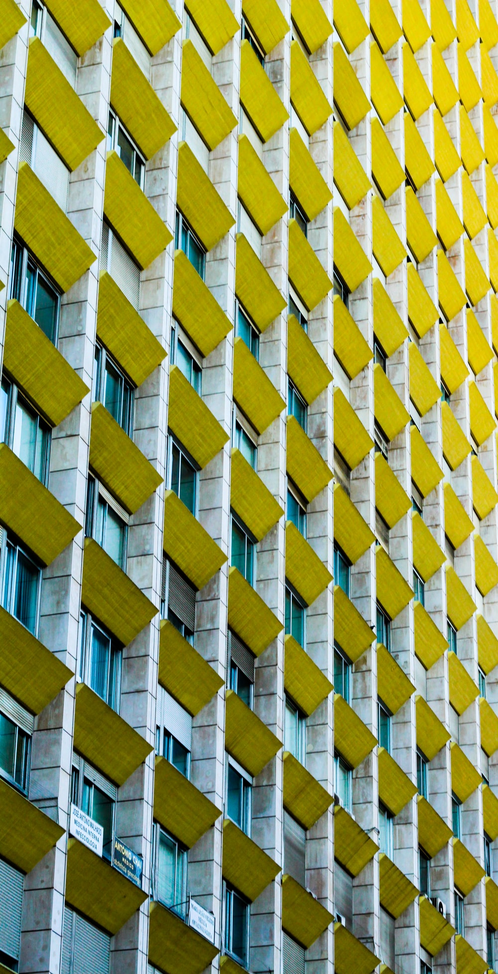 gray and yellow concrete high-rise building view during daytime