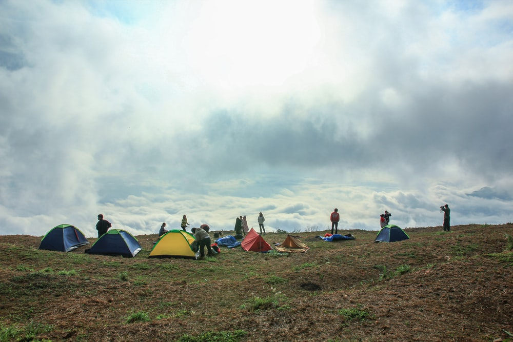 people camping on hill