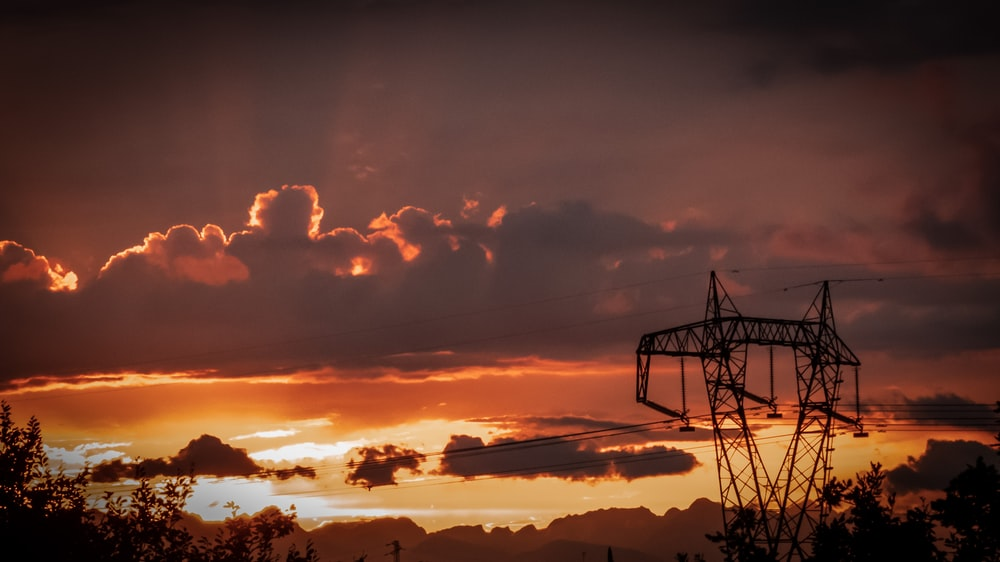 silhouette of utility post during golden hour