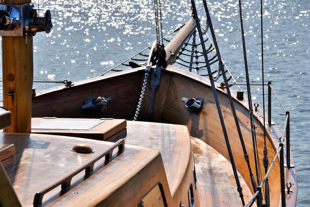 brown wooden ship sailing during daytime